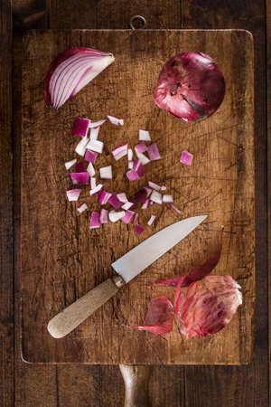 clave: Raw onions over old rustic wood table Stock Photo