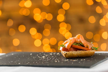 clave: Salmon sandwich over slate plate Stock Photo