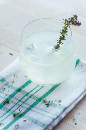 clave: Gin lemonade with thyme cup ready to drink. Filtered image