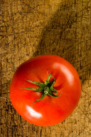 clave: Tomatoes over wooden tableboard with rustic style