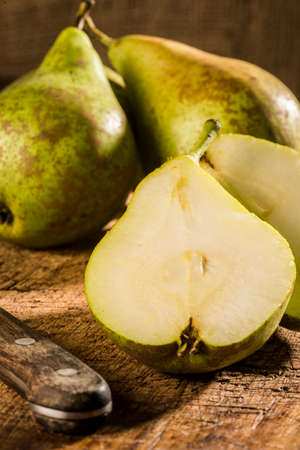 clave: Pears over wooden cutboard in rustic style Stock Photo