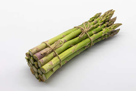 Bunch of green asparagus isolated on a white background