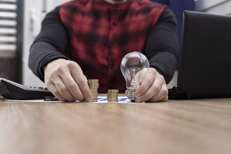 lit bulb with money and a calculator representing business ideas