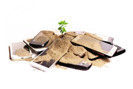 Spoiled smartphones with earth and green sprout coming out Imagens