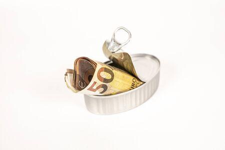 Savings euro bills inside a can of preserves