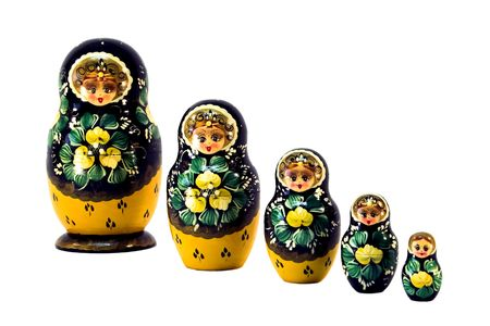 sequential: Five Russian dolls in sequence isolated on white. Stock Photo