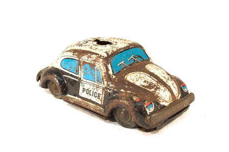 oxidized: Old, rusty tin toy. Police car.