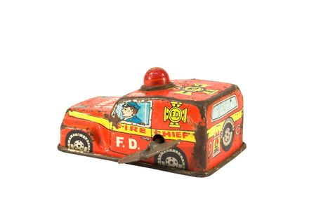 Old, rusty tin toy. Firefighter car. Stock Photo - 794159