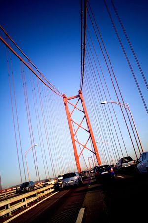 Cars passing through 25 de Abril bridge in Lisbon (Portugal), a twin of the Golden Gate bridge. photo