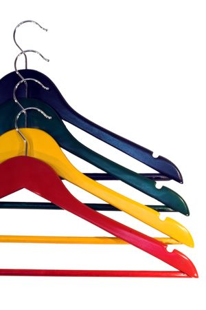 Colorful clothes-hangers isolated on white photo