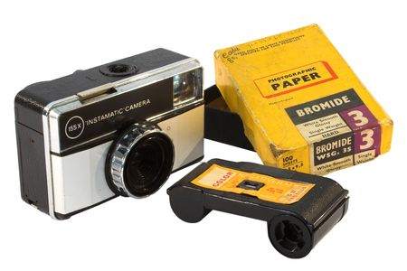 Old, vintage film camera with photo paper and negative roll photo