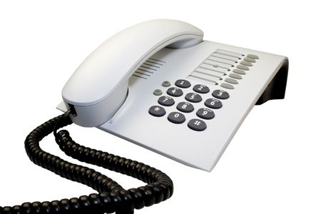 sinuous: Office telephone with sinuous cord isolated on white. Stock Photo