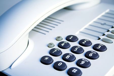 Office telephone. Detail of earpiece and keypad.