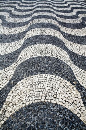 undulation: Detail of a typical portuguese cobblestone hand-made pavement.