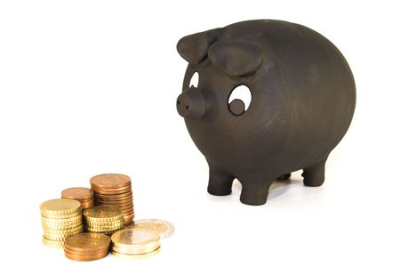 Piggy bank looking at coins photo