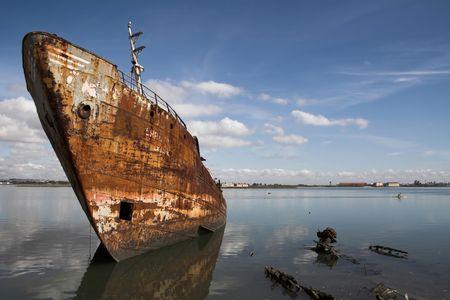 Old fishing ship in a shipyard. photo