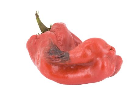 pimento: Rotten Bell Pepper or Pimento isolated on white