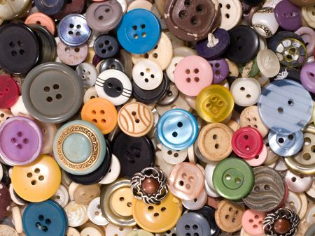 craft button: Pile of old and used clothes buttons   Stock Photo