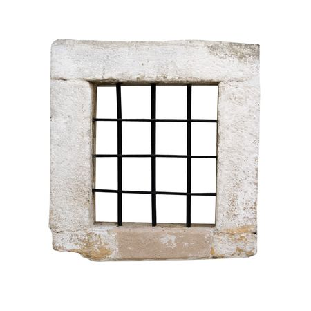 wall bars: Window of an ancient prison cell