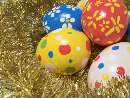 Real hand painted Easter eggs in a golden nest photo