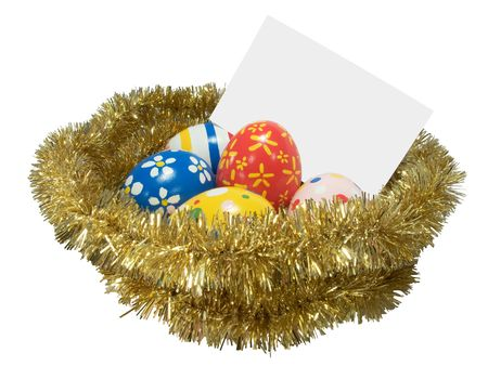 Real hand painted Easter eggs in a golden nest with blank card photo