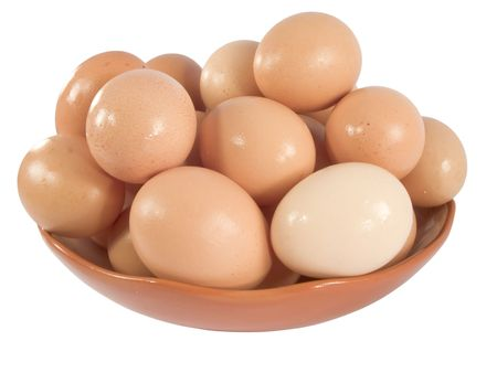 fresh brown chicken eggs on a plate photo