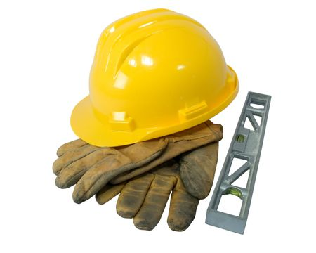 Yellow hardhat, old leather gloves and a level isolated on white background   photo
