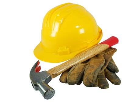 Yellow hardhat, old leather gloves, reflective vest and a hammer   photo