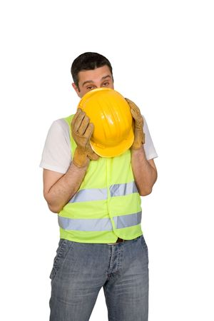 Shy construction worker isolated on white background photo