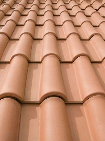 New orange roof tiles close up detail photo