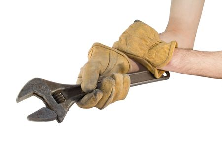 Man holding wrench with leather gloves photo