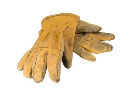 Dirty leather work-gloves Stock Photo