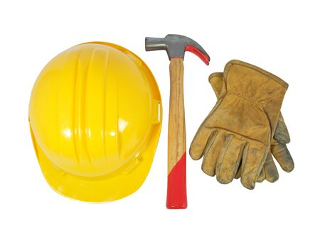 Yellow hardhat, old leather gloves and a hammer isolated on white background photo