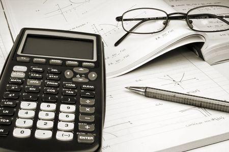 secretarial: Scientific Calculator with exercise books and glasses