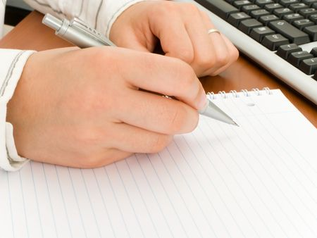 Business woman writing in a notebook  photo