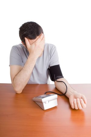 physical pressure: Man feeling sick checking his blood pressure Stock Photo