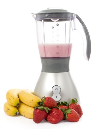 Blender with strawberries and bananas isolated on white background  Stock Photo