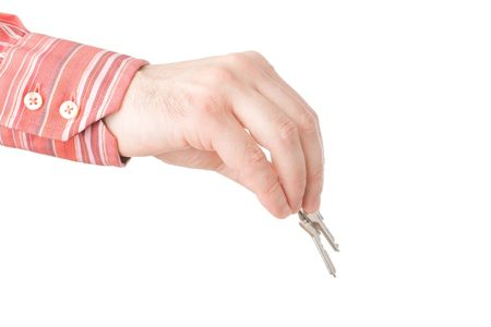 hands holding  giving house keys isolated over whiten photo