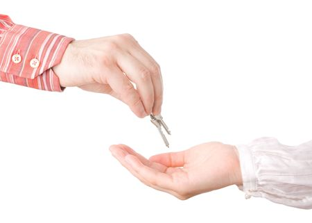 passing over: hands passing house keys isolated over whitern Stock Photo