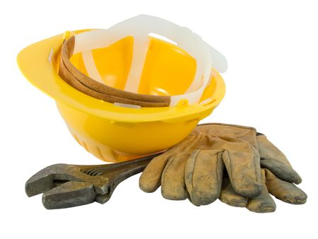 Yellow hardhat, old leather gloves and wrench isolated on white background Stock Photo - 3150470