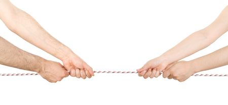 Man and woman pulling a rope in opposite directions  photo