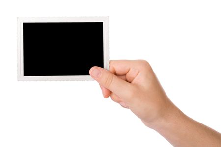 Hand holding a photograph isolated on a white background
