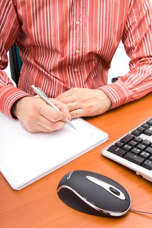 Business man writing in a notebook  photo