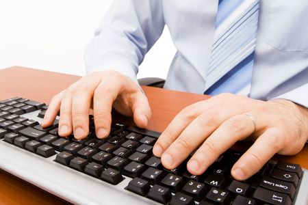 Man typing in the computer keyboard  photo