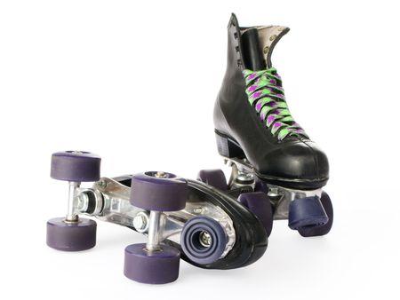 to skate: Retro patines aislados en fondo blanco