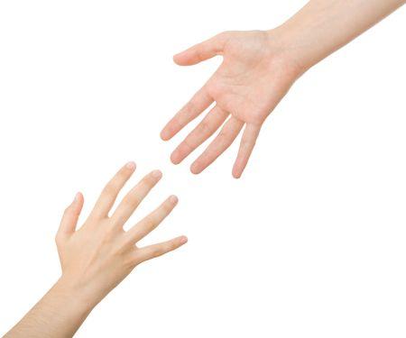 Raggiungendo mani. Concetto per il salvataggio, l'amicizia, l'orientamento ...