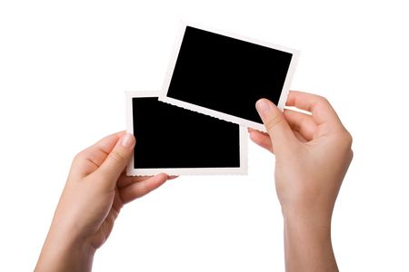 give out: Hands holding a photograph isolated on a white background