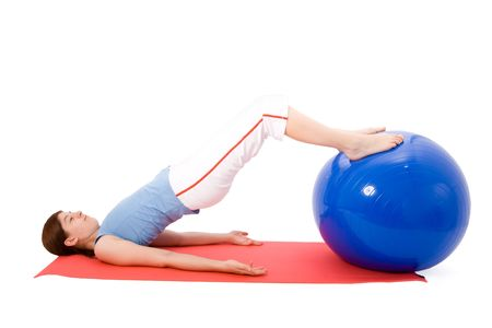 Young woman performing fitness exercises with a fitness ball photo