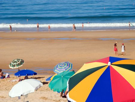 Crowded beach at summer with sun umbrellas  Stock Photo