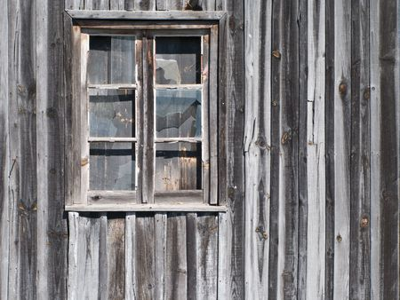 decaying: old wooden barn window with glasses cracked Stock Photo